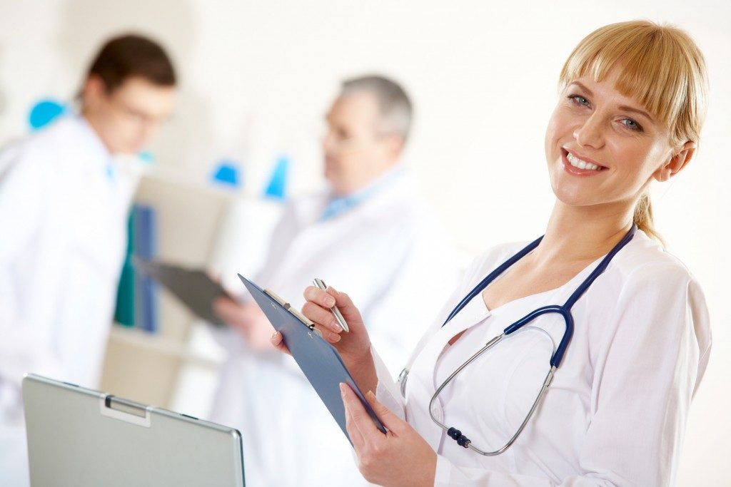Happy nurse with clipboard and stethescope